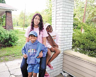 Girl Scouts Ja-Kayla Martin, 5, left, and Ja-Kyra Martin, 7, with their mother and former Girl Scout Kendra Allen. Allen started Troop 80171, sponsored by Zionhill Baptist Church, 220 Jefferson St., nearly two years ago.