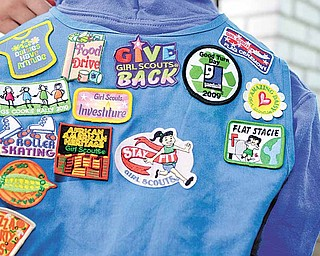 Girl Scout patches collected by Ja-Kayla Martin.