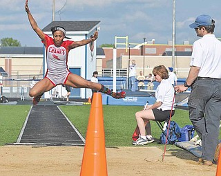 Senior Shatasia Walker of Chaney High School competes in the girls long jump Friday during the second day of competition at the Division I district track meet at Austintown Fitch High School. Walker qualified for regional competition in two events — the 100-and 300-meter hurdles — and could be the last athlete to compete for Chaney. The school will drop athletics after this season.