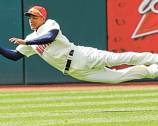 Cleveland Indians center fielder Ezequiel Carrera catches a fly ball hit by Cincinnati Reds' Paul Janish in the ninth inning in a baseball game, Sunday, May 22, 2011, in Cleveland. The Indians won 12-4.