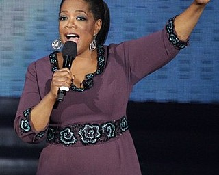 """In this May 17, 2011 file photo, Oprah Winfrey acknowledges fans during a star-studded double-taping of """"Surprise Oprah! A Farewell Spectacular, in Chicago. """"The Oprah Winfrey Show"""" is ending its run May 25, after 25 years."""