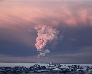 In this photo taken on Saturday, May 21, 2011,  smoke plumes from the Grimsvotn volcano, which lies under the Vatnajokull glacier, about 120 miles, (200 kilometers) east of the capital, Rejkjavik, which began erupting Saturday for the first time since 2004.  Iceland closed its main international airport and canceled domestic flights Sunday as a powerful volcanic eruption sent a plume of ash, smoke and steam 12 miles (20 kilometers) into the air.