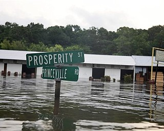 A street sign is seen in floodwaters from the rising Mississippi River in St. Francisville, La., where a dozen homes and businesses, and several camps, were flooded, Friday, May 20, 2011.   Residents were leaving in the face of a mandatory evacuation order set to kick in on Saturday as Mississippi River water flowing through the Morganza spillway is expected to reach communities in the Atchafalaya Basin.