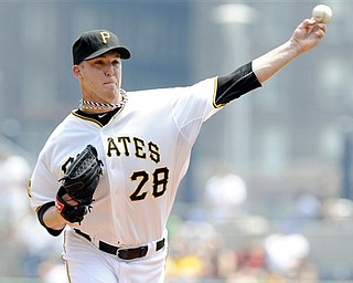 Pittsburgh Pirates starting pitcher Paul Maholm (28) delivers a pitch against the Detroit Tigers during the first inning of a baseball game, Sunday, May 22, 2011 in Pittsburgh. Pittsburgh  lost 2-0.