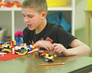 Ethan Niemczura works with Legos at The Potential Development Center on Youngstown's South Side.
