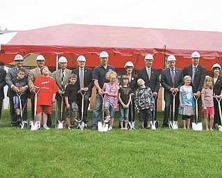 Board members, school officials,  students and others working on the  $50 million Austintown schools construction project gathered Tuesday, top, to break ground outside Frank Ohl Intermediate School.