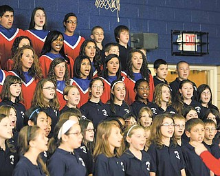 Austintown Fitch High School and Frank Ohl Intermediate School choirs sang the national anthem on Tuesday as school officials broke ground on a $50 million building project. The Ohio School Facilities Commission is funding about 47 percent of the project, and Austintown schools will fund the rest through a 2.9-mill bond issue passed by voters in May 2010.