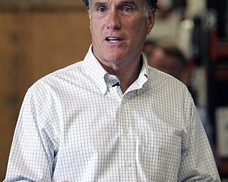 In this May 21, 2012, photo, possible 2012 presidential hopeful, former Massachusetts Gov. Mitt Romney speaks  to a group of small business owners on the economy during a visit to Meetze plumbing in Irmo, S.C. In the Republican field, Romney is clearly the man to beat. Long before the GOP's first primaries, with Mitch Daniels out, others, including Tim Pawlenty and Jon Huntsman, still have hopes.