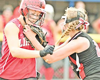 Columbiana baserunner Hayley Goist, left, is tagged out by Mathews first baseman Maddie Grimes during Wednesday's regional softball game at Kent State University. The Clippers rallied for an 11-9 victory.