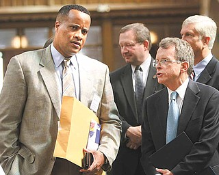 Attorney General Mike DeWine, right, talks with Mayor Jay Williams after announcing the Fugitive Safe Surrender program would come to Youngstown next year. The two were part of a safety summit Wednesday at St. Dominic Church on the city's South Side.