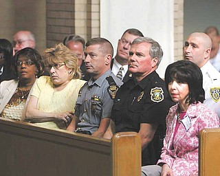 Officials from a variety of law-enforcement jurisdictions, such as Lt. Christopher Heverly of the Ohio State Highway Patrol, left, and Boardman Police Chief Jack Nichols, attended a safety summit Wednesday at St. Dominic Church on  Youngstown's South Side.