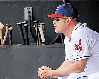 In this photo taken May 25, 2011, Cleveland Indians manager Manny Acta watches from the dugout during a baseball game against the Boston Red Sox in Cleveland. The club's second-year manager spent all spring telling anyone who would listen that he expected the Indians, who lost 93 games last season, to contend in 2011. With Acta making smart, timely moves _ and a little luck _ they have baseball's best record.(AP Photo/Mark Duncan)