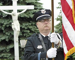 Youngstown Patrolman Richard Baldwin was part of the color guard at the annual Fallen Officers Memorial ceremony at Our Lady of Mount Carmel Church, Youngstown.