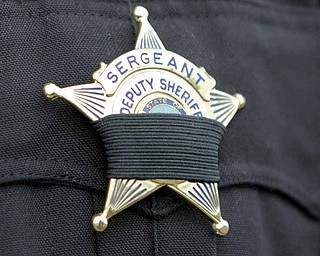 All officers who attended Friday's ceremony wore black bands over their badges.