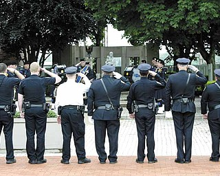 Youngstown police officers salute those who lost their lives in the line of duty. Mahoning County Fraternal Order of Police Lodge 141, Youngstown FOP Lodge 28 and Youngstown State University FOP Lodge 200 sponsored the event.