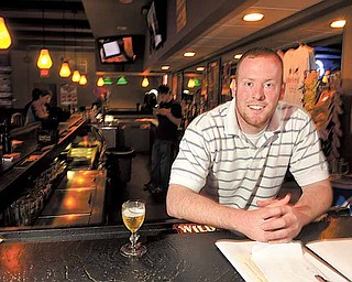 Neale Booth, nephew of Bill and Melissa Booth, is a bartender at Backyard Bar and Grill. The establishment, on State Route 170, just south of Western Reserve Road, opened recently after Bill and Melissa Booth said they wanted to bring a family-friendly bar and grill  to town.