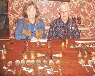 """Next ... here come the brides: Judith and Terry Sheridan display a collection of pewter molds and pewter items at a recent open house at Upton House in downtown Warren, at 380 Mahoning Ave. NW. At 2 p.m. Sunday, the second open house will take place. It's titled """"Here Come the Brides"""" and will feature vintage wedding gowns dating from 1905 to 1945. There also will be displays of wedding shoes, veils, gloves and bride dolls. For more information phone 330-395-1840 or visit www.uptonhouse.org."""
