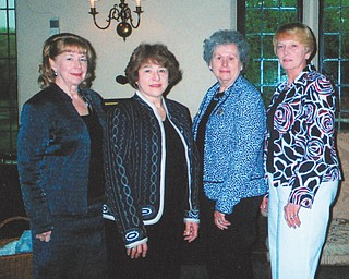 Members of the Youngstown Area Federation of Women's Clubs met recently for a scholarship luncheon at the Youngstown Country Club. From left to right are Barbara Higgins, second vice president; Valorie Zurawick, Woman of the Year; Atty. Evelyn Bachman, Ohio Federation of Women's Clubs president; and Rusti Puromaki, first vice president. Not pictured are Debra Kostelic, federation president, and YSU student Megan Harwell, who received a $2,500 scholarship during the luncheon.