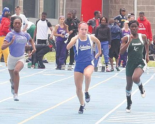 Lauren Schattinger of Lakeview wins the girls 100 meter dash Saturday afternoon in Ravenna.