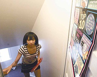 Ky'Heir Finger, a sixth-grader at P. Ross Berry Middle School, walks upstairs to a tutoring session at Beatitude House, where she's lived for two years.