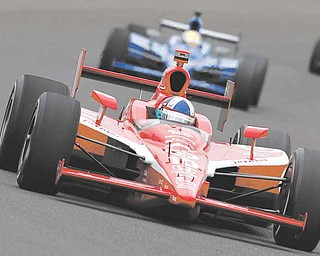 IndyCar driver Dario Franchitti, of Scotland, heads into a turn on the final day of practice for the Indianapolis 500 auto race at the Indianapolis Motor Speedway in Indianapolis, Friday, May 27, 2011. The 100th anniversary running of the Indianapolis 500 is scheduled for Sunday. (AP Photo/Tom Strattman)