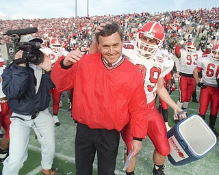 Jim Tressel gets a playful pat on the head from a player who missed him with the Gatorade bucket following the Penguins 1994 Div I-AA National Championship win over Boise State.