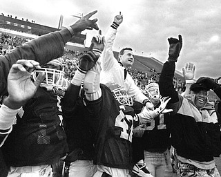 Youngstown State University coach Jim Tressel celebrates an undefeated season in 1990 after defeating the University of Maine.