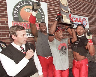 Jim Tressel and his player during the trophy presentation following their Div I-AA National Championship win over McNeese State in 1997.