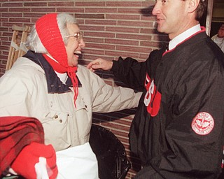 Jim Tressel gets a hug from his mother Eloise after deafeating Washington State to advance to the Div I-AA national championship game in 1997.