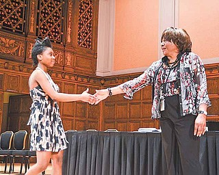 Chaney High School senior Dasia Square practices walking across the stage at Stambaugh Auditorium in Youngstown. Commencement practice was Wednesday afternoon; today is the real thing for Square and her classmates.