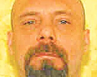 This undated photo provided by the Ohio Department of Rehabilitation and Correction shows death row inmate Kenneth Smith. The 45-year-old Smith is scheduled to die July 19 for killing Lewis and Ruth Ray in their Hamilton home in 1995. Ohio will make it easier for a Smith who lost his larynx to cancer to make a final statement at his execution, a gesture of flexibility the state argues is one more reason a federal judge should dismiss a lawsuit challenging Ohio's execution procedures(AP Photo/Ohio Department of Rehabilitation and Correction)