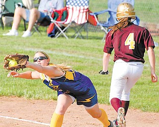 Haley McAllister, seen above reaching for a throw, and her teammates on the undefeated 2011 Champion softball team are trying to do what the 2006 team could not: leave the state tournament with a championship trophy. They could move closer to their goal today against Bellville Clear Fork in a Division III state semifinal game.