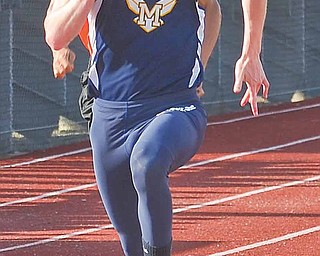 Miles Dunlap of Mcdonald wins the boys 100 Meter  competition at the ITCL Tier 2 track meet held at Western Reserve High School.