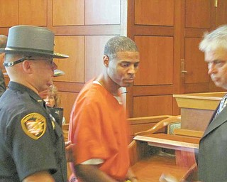 """Frederick D. Johnson is led from the courtroom after Judge Peter Kontos of Trumbull County Common Pleas Court sentenced Johnson to 32 years in prison for being a """"major  drug offender."""""""