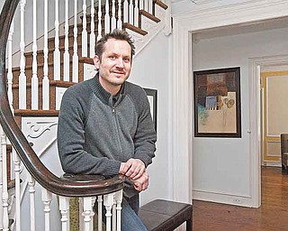 """Stager Mark Miklosovich stands in the Wynnewood home that he and his partner, Anna Powers, worked on. The two """"suggest things,"""" Powers said - """"for instance, adding a piece of furniture."""" (Akira Suwa/Philadelphia Inquirer/MCT)"""