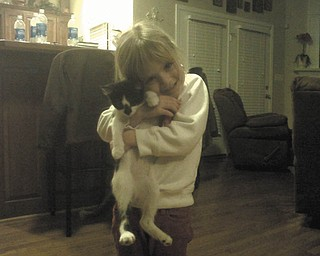 The kitty's name is Chet, and he is 7 months old. Anthony and Beth Jones of Lumberton, N.C., adopted him on Christmas Eve 2010 for their daughter, Natalie (grandaughter of Gary and Ann Duracky of Poland).