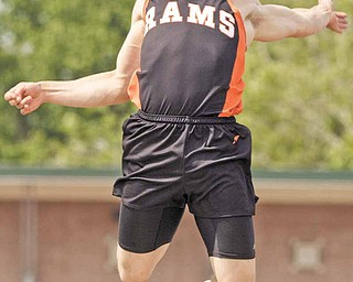 """Mineral Ridge's Dan Skiba makes his third attempt in the long jump during the boys Division III State High School Track Meet at Ohio State University Friday, June 3, 2011. Skiba went 24' 5.25"""" on the attempt to win the event."""