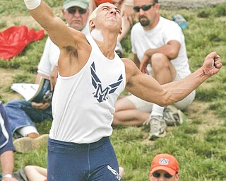 """McDonald's Matthias Tayala releases his second throw in the shot put finals during the boys Division III State High School Track Meet at Ohio State University Friday, June 3, 2011. Tayala's throw went 64' 8"""" to give him the title."""