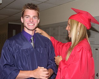 FITCH - Eric Vereb is all smiles as Kellie Wenick helps get him ready for graduation Saturday morning at Fitch. - Special to The Vindicator/Nick Mays