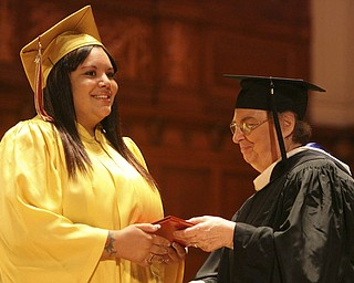 ROBERT  K.  YOSAY  | THE VINDICATOR --..Brooklyn native Najah Morgan receives her diploma from Siter Jane Marie - principal - Cardinal Mooney's 53 Annual Commencement  at Stambaugh Auditorium . -30-..(AP Photo/The Vindicator, Robert K. Yosay)