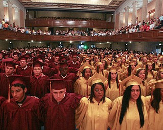 ROBERT  K.  YOSAY  | THE VINDICATOR --..Arm in Arm... the senior class sings the alma mater one last time as a group---Cardinal Mooney's 53 Annual Commencement  at Stambaugh Auditorium . -30-..(AP Photo/The Vindicator, Robert K. Yosay)