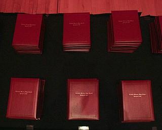 ROBERT  K.  YOSAY    THE VINDICATOR --..Diplomas are ready as Cardinal Mooney's 53 Annual Commencement  at Stambaugh Auditorium . -30-..(AP Photo/The Vindicator, Robert K. Yosay)