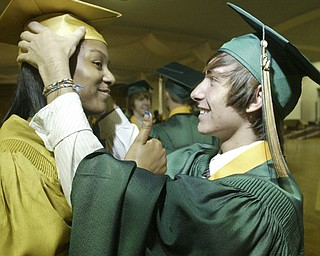 William Lewis the vindicator   Ursuline grad Amani Noble gives the thumbs up sign as fellow grad Taylor Hartman adjusts her cap before Saturday ceremony at Stambaugh Auditorium.