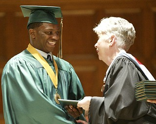 William d Lewis the Vindicator Ursuline grad and football standout Akise Teague gets diploma from principal Patricia fleming during Saturday commencement at Stambaugh Auditiorium