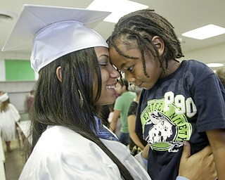 William D Lewis The Vindicator  Boardman HS grad Shavai Owens, one of 6 wounded in Febuary shooting near YSU, hugs her brother Dinari Ferguson, 4, after commencement which was held Sunday at the HS.