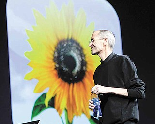 Apple CEO Steve Jobs gives the keynote address to the Apple Worldwide Developers Conference in San Francisco, Monday, June 6, 2011.  (AP Photo/Paul Sakuma)