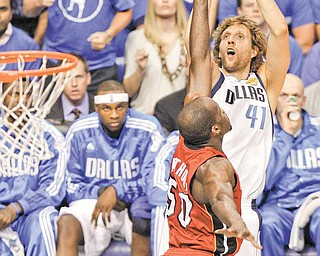 Dallas Mavericks' Dirk Nowitzk shoots over Miami Heat's Joel Anthony (50) during the first half of Game 4 of the NBA Finals basketball game Tuesday, June 7, 2011, in Dallas. (AP Photo/LM Otero)