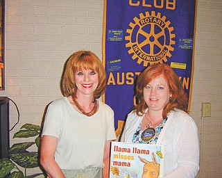 Sharing the knowledge: Elaine Bozick, a past president of the Rotary Club of Austintown, at left, spoke to the club recently about being Ohio team leader for a Group Study Exchange. In the most recent GSE program, young businesspeople and professionals traveled to the Philippines to visit vocational exchange partners, Rotary International District 3820 in the region southeast of Luzon. The program is directed by the Rotary Foundation, whose mission is to enable Rotarians to advance global understanding, good will and peace. At right is Susan Leetch, president of the Austintown Rotary.