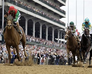 In this May 7, 2011 file photo, John Velazquez, left, rides Animal Kingdom, to victory during the 137th Kentucky Derby horse race at Churchill Downs in Louisville, Ky. The anticipation of a Triple Crown try was building as Kentucky Derby winner Animal Kingdom was closing in on Shackleford in the final yards of the Preakness Stakes. The colt's gallant bid, however, came up short - by a mere half length. (AP Photo/David J. Phillip, File)