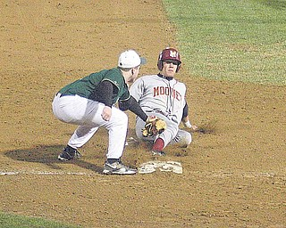 BASEBALL - (5) Harrison Finelli of Ursuline puts the tag on (21) Boo Vazquez during a recent game